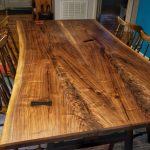Bookmatched walnut dining table.